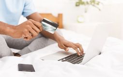 Man purchasing product online, using credit card to pay stock photo