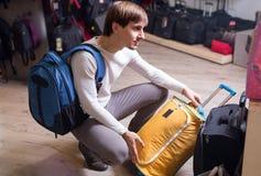 Man purchasing stylish suitcase Stock Images