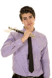 Man in purple dress shirt and hatchet on shoulder Royalty Free Stock Image