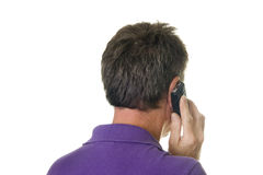 Man in purple shirt on cell phone Royalty Free Stock Images