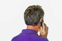 Man in purple shirt on cell phone Royalty Free Stock Photo
