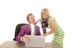 Man purple suit computer woman grab tie choke Royalty Free Stock Image
