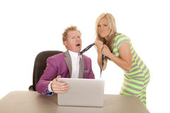 Man purple suit computer woman grab tie mad Royalty Free Stock Photos