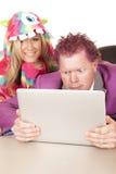 Man purple suit computer woman pajamas over shoulder smile Stock Photos