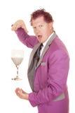 Man purple suit drink between hand look Royalty Free Stock Image