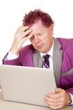 Man purple suit and hair laptop thinking Stock Photo
