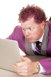 Man purple suit and hair look at laptop Royalty Free Stock Photo