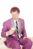 Man purple suit hold drink look down Stock Photo