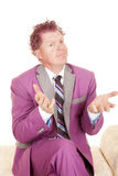 Man purple suit sit hands out Stock Images