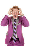 Man purple suit stand hands hair scream Royalty Free Stock Image
