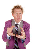 Man purple suit stand hands out cray hair Stock Image