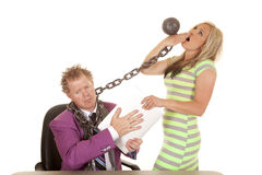 Man purple suit woman green dress chain yawn laptop Stock Photo