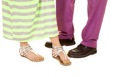 Man purple suit woman green dress feet close Royalty Free Stock Photos
