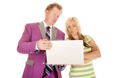 Man purple suit woman green dress hold laptop serious Royalty Free Stock Images