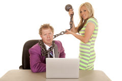 Man purple suit woman green dress laptop chain pull Royalty Free Stock Image