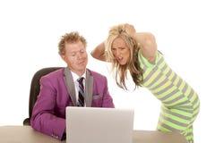 Man purple suit woman green dress laptop frustration Stock Photography