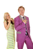 Man purple suit woman green dress laugh. A men and women standing together the women is laughing Stock Photo