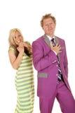 Man purple suit woman green dress laugh Stock Photo