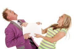 Man purple suit woman green dress pull hard laptop Stock Photo