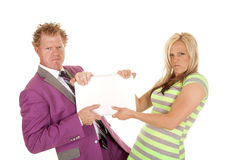 Man purple suit woman green dress pull laptop Royalty Free Stock Photos