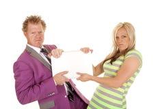 Man purple suit woman green dress pull laptop Royalty Free Stock Photos