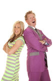 Man purple suit woman green dress stand laugh Royalty Free Stock Photo