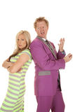 Man purple suit woman green dress stand mad Royalty Free Stock Photography