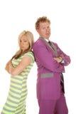 Man purple suit woman green dress stand sad Royalty Free Stock Photo