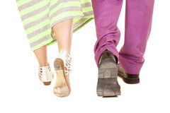 Man purple suit woman green dress walk away feet Royalty Free Stock Photos
