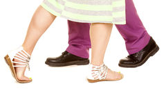 Man purple suit woman green dress walk pas feet Royalty Free Stock Image