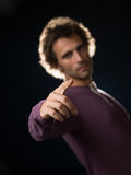 Man in purple sweater gestures Royalty Free Stock Images