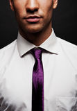 Man with purple tie Royalty Free Stock Photography