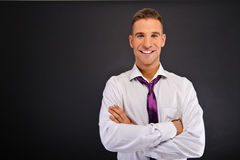 Man with purple tie over dark background Stock Images