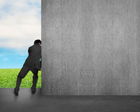 Man push away concrete wall Stock Photos
