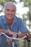 Man with push bike Stock Image