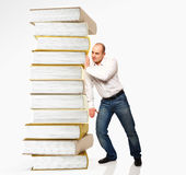 Man push book pile Royalty Free Stock Photos