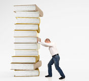 Man push book pile Stock Images
