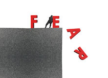Man push red fear word down on top of building. Man push red fear word down on top of concrete building isolated on white background, overcoming fear concept stock illustration