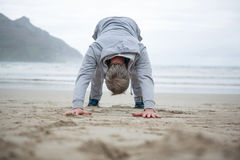 Man push-up on beach royalty free stock photography
