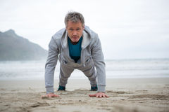 Man push-up on beach. During winter royalty free stock photography