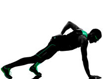 Man push ups exercises fitness silhouette. One man exercising push ups fitness in silhouette isolated on white background royalty free stock photo