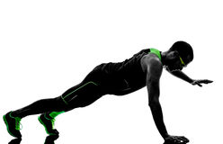 Man push ups exercises fitness silhouette Stock Photography
