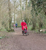 Man and Pushchair. WORCESTER,UK - MARCH 15 2014 : Competitors take part in a Park Run on March 15 2014 in Worcester,UK. Park Run races are held every Saturday in Royalty Free Stock Photos