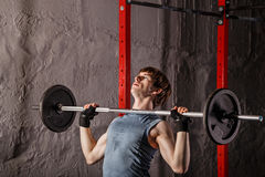Man pushes the bar. Stock Photography