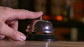 Man pushes call bell at hotel arm stock video