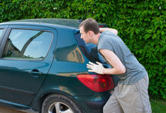 The man pushes car. The man pushes the car Royalty Free Stock Photos