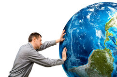Man pushes the planet on a white background. Stock Photo