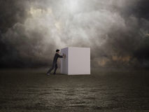 Man pushing a box Royalty Free Stock Photos