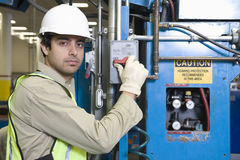 Man Pushing Button In Factory Royalty Free Stock Photography