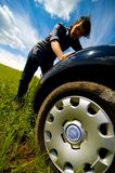 Man Pushing Car. A man pushing a broken down car in the middle of nowhere Royalty Free Stock Photos